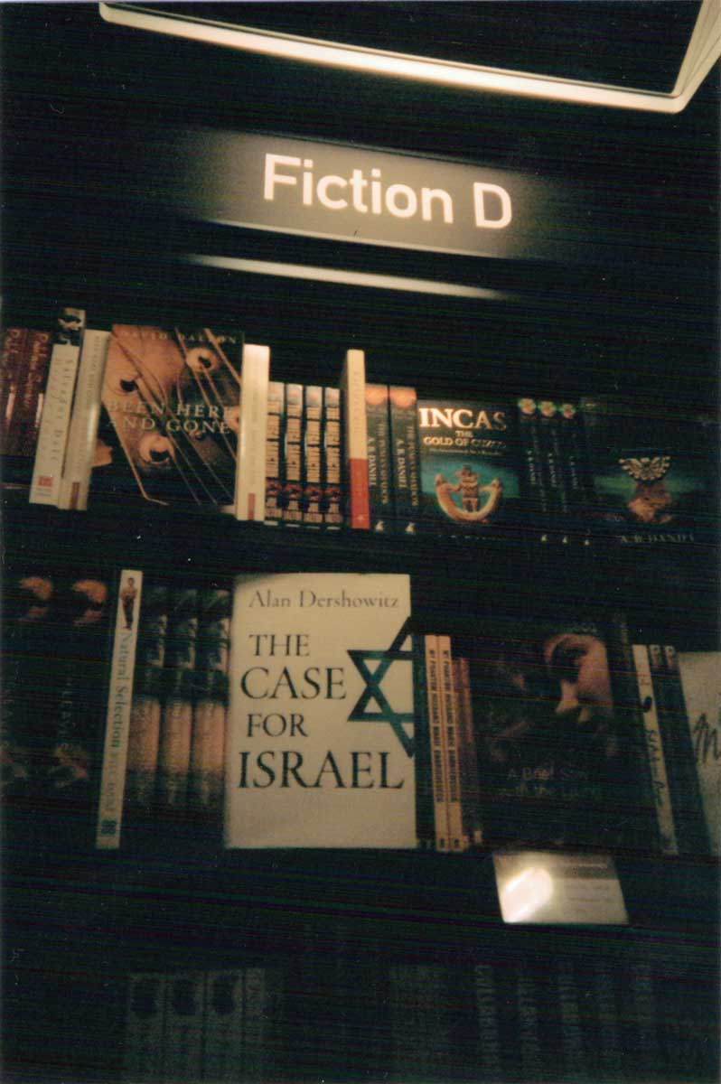 """The fiction section in a book shop with a book called """"The Case for Israel"""" facing front"""