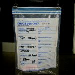 police drugs evidence bag with hand written notes to identify contents etc