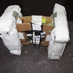 camera encased in cardboard and foam tied together with cable ties