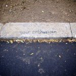 'your enthusiasm' hand written on a curb