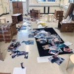 the studio with cardboard boxed and magazine cut outs all over the floor